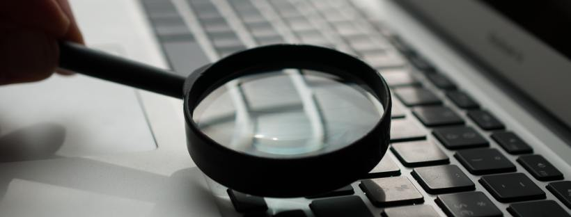 Magnifying glass over computer keyboard